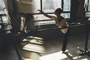 Ballet dancer practicing indoors.