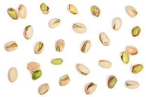 Pistachios isolated on white background, top view. Flat lay pattern