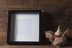 Blank photo frame and hyacinth plant