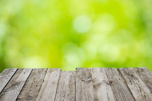 Wooden desk with green blur