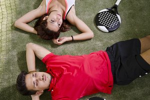 Paddle tennis tired couple team