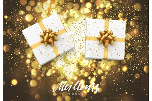 Meilleurs voeux Joyeux Noel. Christmas background with gift box and golden lights bokeh.