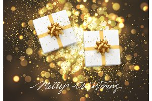 Christmas background with gift box and golden lights bokeh. Xmas greeting card.