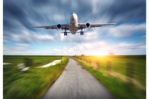 Aircraft and rural road with motion blur effect