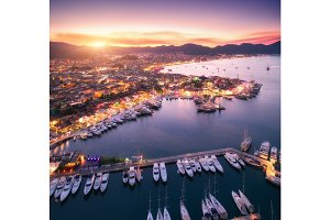 Aerial view of boats and beautiful city at sunset in Marmaris, T