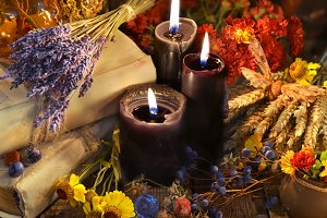 Black candles and lavender flowers