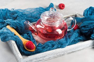 Raspberry tea in glass teapot