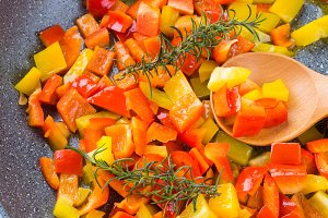 Cooking bell peppers with rosemary