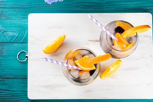 Drink with blackberries and orange, ice
