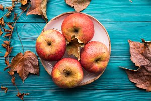 Red apples on Green autumn background