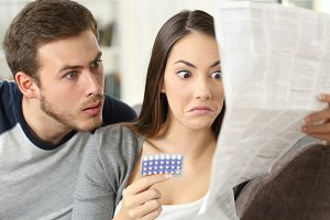 Suspicious couple reading a leaflet