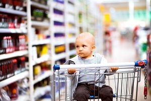 Little baby boy at the supermarket.