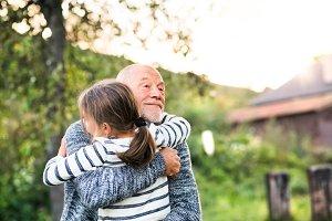 Grandfather giving his grandaughter a hug.