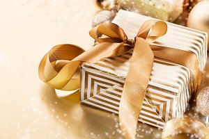 Gold gifts on golden background