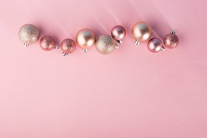 Pink baubles in row