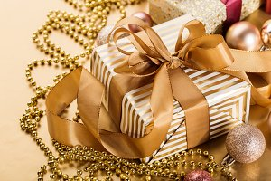Golden gifts on golden background