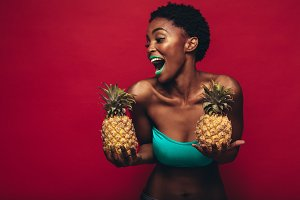 Black woman with pineapples