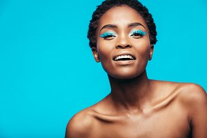 African woman with blue eye shadow