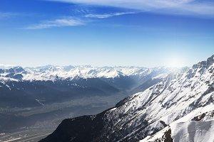 Bright sunlight in snowy mountain valley