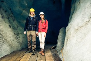 Team Of Scientists Examining A Glacier