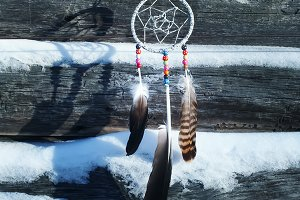Dream catcher on wooden wall