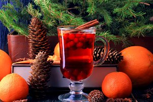 Hot winter drink with cranberry orange and cinnamon
