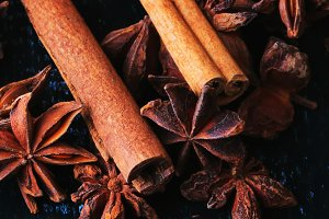 cinnamon and anise on a dark wooden background