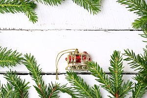 Frame of fir branches Christmas locomotive white wooden background