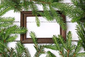 wooden frame for photo spruce branches white wooden background
