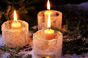 Christmas background fir tree burning candle Winter background