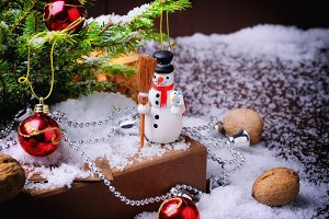 Christmas composition fir tree snowman snow cones walnuts