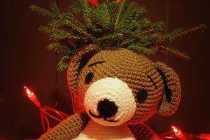 Christmas winter card with teddy bear and Christmas tree with lights
