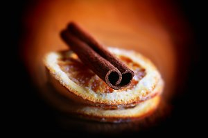 blurred background cinnamon and dried orange christmas mystic retro