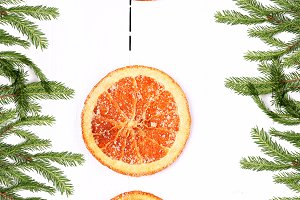 New Year background Christmas tree with dried orange on a white wooden top view view from above greeting the winter brochures, postcards, magazines
