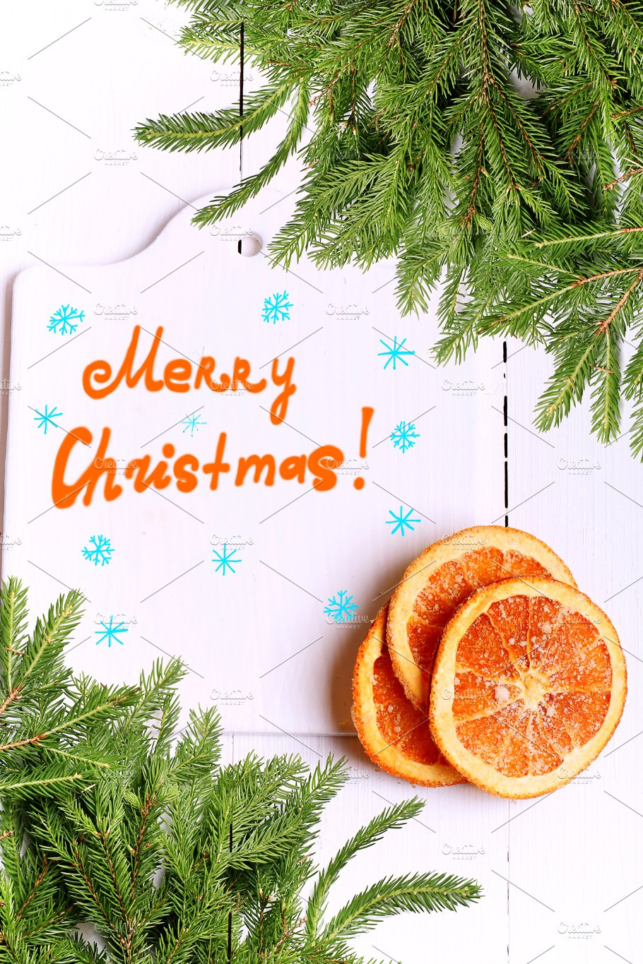 new year background christmas tree with cutting board with the words merry christmas and with dried oranges on a white wooden view from above greeting