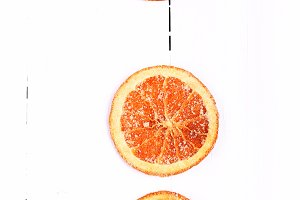 Christmas Background with dried oranges on a white wooden top view view from above greeting the winter brochures, postcards, magazines