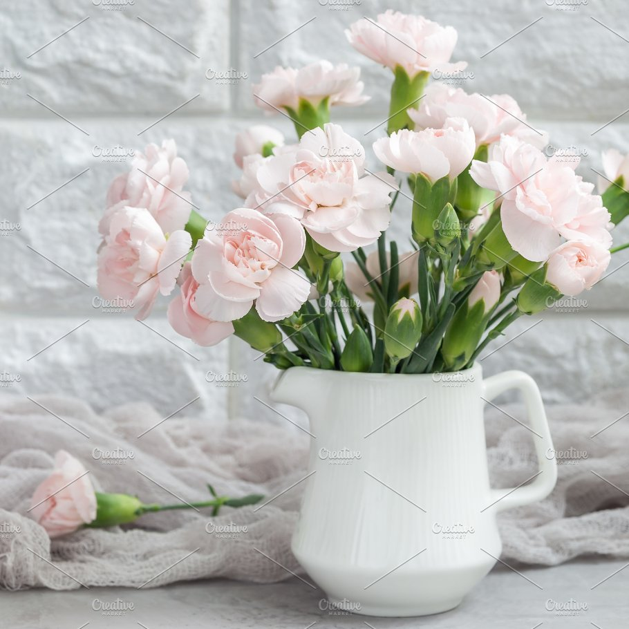 Small tender pink carnation flowers in vase on gray concrete small tender pink carnation flowers in vase on gray concrete mothers day greeting card background reviewsmspy