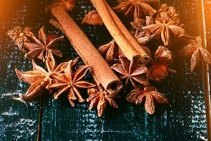anise and cinnamon spices on the old wooden background