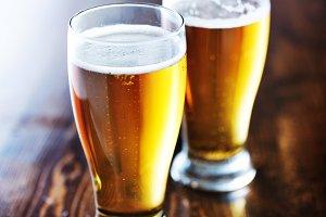 two mugs of amber beer
