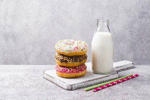 Multicolored Donuts tower and milk in bottle