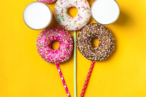 Balloon of donuts and milk on yellow background