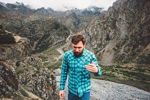 Bearded Man walking in mountains