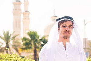 Arabian Man Standing In Front Of Mosque