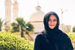 Arabian Woman Standing In Front Of Mosque