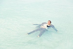 Businessman Floating In The Sea