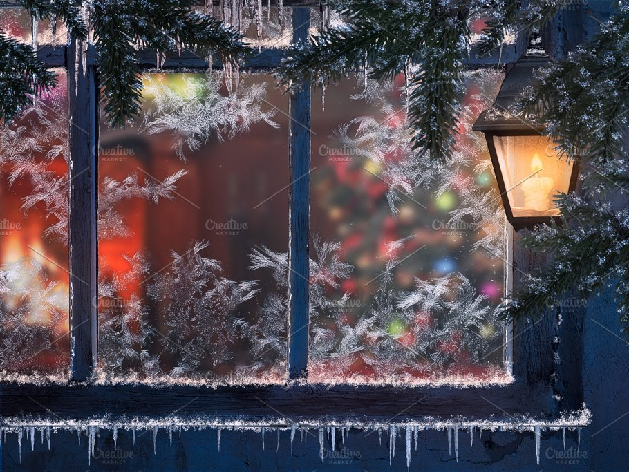 beautiful christmas window snow lights a lantern icicles through the window you can see the room with the fireplace and the christmas tree