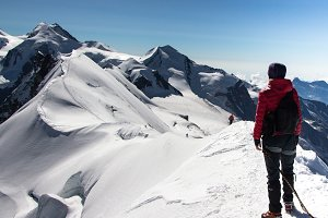 Hiker woman on top of Breithorn