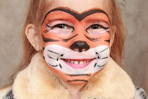 Smiling girl in the image of a tiger