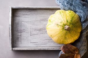Autumn background with wooden tray