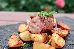 Tenderloin steak and fried potatoes
